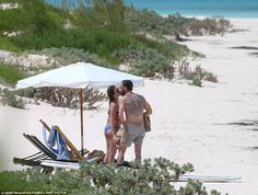 Smooch: It was a particularly romantic, lingering kiss that saw them savour the moment in the sands