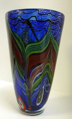 Add some flowers and an LED light base to highlight the beauty of this hand blown murano glass vase.