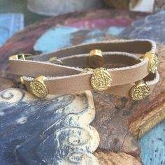 Leather Wrap Bracelet with Gold embellishments Tan leather wrap with St. Benedict gold embellishments. I love this bracelet for several reasons but one is the tasteful magnetic closure.  So cute with other stackables  or worn alone. All sales final Jewelry Bracelets