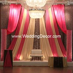 Flat and A-line Backdrop - brown blockout with fuchsia and gold a-line - extentions in fuchsia with accents of crystal columns and crystal curtains