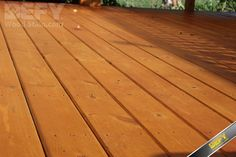 Horizontal pressure treated deck boards stained with DEFY Extreme Wood Stain cedar tone
