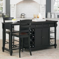 Your kitchen will stand out with this hardwood kitchen island with stools. The black finish is complemented by the cherry top, and the wine racks help organize your collection. The two chairs provide a place to relax and enjoy dinner and a drink.