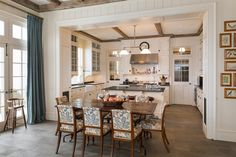 Classic white eat-in kitchen in New York - Miles Redd & Gil   Schafer  - like the print on the chairs