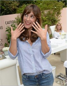 Funny girl Lindsay Sloane shows off her essie mani at the Hotel Bel-Air.