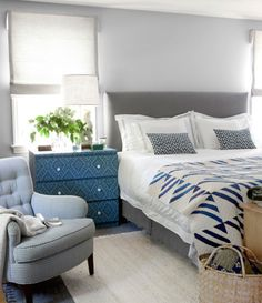 love the chair in this master bedroom and the painted chest.. yum yum