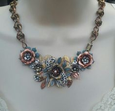 Mixed Metal Challenge with B'Sue flowers and leaves in Silverware, Copper, Raw Brass and Verdigris with no hole pearls and Vintage Chain in Red and Antique brass.