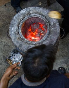 "An image of a tandoor oven, which was used in the novel by Mariam when she prepared her first meal for Rasheed. ""Once she floured the dough, she wrapped it in a moist cloth, put on a hijab and set out for the communal tandoor."" (65)"