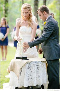 Outdoor Christian wedding ceremony: unity cross ceremony.