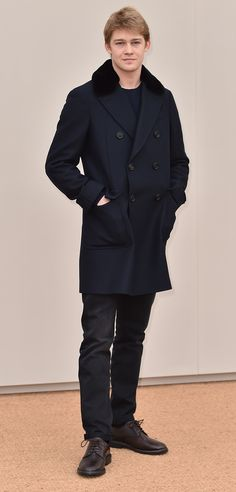 Joe Alwyn wearing a double-breasted Burberry coat to the January 2016 Menswear show