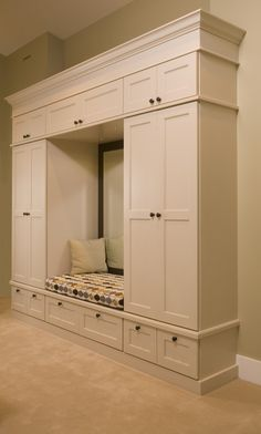 This would be a great set-up for a mudroom setting just inside the garage...compartments for everyone! :)