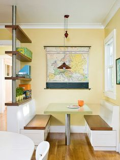 A generous-size banquette paired with fun and funky touches is a family-minded design. Straight lines offer a modern look and avoiding upholstery makes the space easy to clean. Brightly colored shelf accessories enliven the space. A map is unexpected artwork and adds a unique vibe to the space.