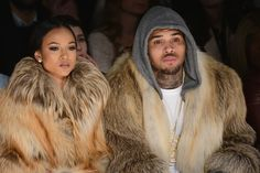 Karrueche Tran Photos - Karrueche Tran (L) and Chris Brown attends the Michael Costello fashion show during Mercedes-Benz Fashion Week Fall 2015 at The Salon at Lincoln Center on February 17, 2015 in New York City. - Michael Costello - Front Row - Mercedes-Benz Fashion Week Fall 2015