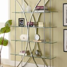 """The graceful shape of this """"X"""" motif metal bookcase contributes storage with an airy, contemporary design for your home. The chrome finish over the metal frame and stronger tempered glass floating style shelves. Glass Bookcase, 4 Shelf Bookcase, Metal Bookcase, Metal Shelves, Bookcases, Bookshelf Ideas, Bookshelf Design, Book Shelves, Wall Shelves"""
