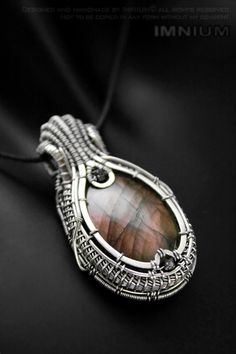 Labradorite and black diamond pendant - polished stone wrapped in sterling and fine silver. Unique wire wrap