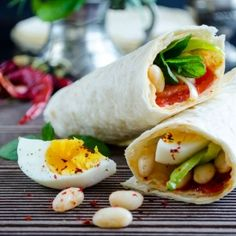 Burritos stuffed with boiled beans, veggies and egg.