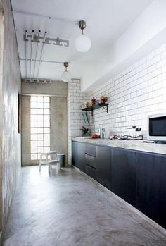 Typical HDB kitchen layout. Industrial themed. polished cement flooring with distressed kitchen cabinets - Nadiah Rosman