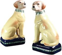 Yellow dogs.  Charming.  http://www.wellappointedhouse.com/Products/152465-the-well-appointed-house-pair-of-porcelain-yellow-lab-dogs.aspx