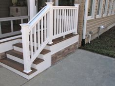 #Deck steps with white PVC railing,  Fiberon Decking flooring, and stacked stone side.