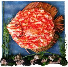 Discus Fish - Bespoke Funeral Flowers and Tribute Art by Monica F Hewitt Florist Sheffield http://www.monicafhewitt.co.uk/