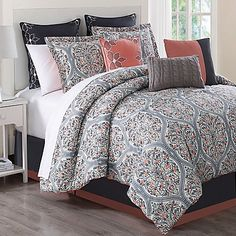 Bring chic sophistication to your bedroom with the unique Grace 9-Piece Comforter Set. Accented by beautiful damasks in cool grey and coral hues, the stylish bedding is an eye-catching addition to any room's décor.