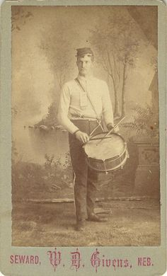 CDV View of an uniformed drummer, with a  Givens, Seward, Neb. photographer's imprint. Givens was active 1882 -1893. Uncertain as the the exact nature, by the date of this photo, the nearby forts of Fort Atkinson or Fort Kearney were long gone