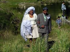 An Ethiopian bride wore a white wedding gown and veil while a matching flower girl sat beside her.