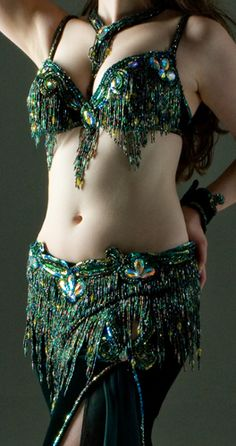 Deep green with tiny amount of gold. Heavy fringe dance belt and bra
