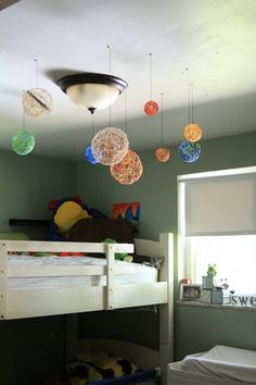 Embroidery thread soaked in glue/water and wrapped around balloons...turned into an AWESOME solar system decoration for a kids room! =like the solar system spin on this concept....