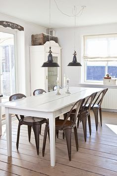 Love the tolix chairs with the white table and lamps, very beachy- get barstools with tall backs  for Sullivan