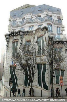 Amazing!!  This is not a visual illusion or a miracle photoshop. This building is actually located in Paris, France!