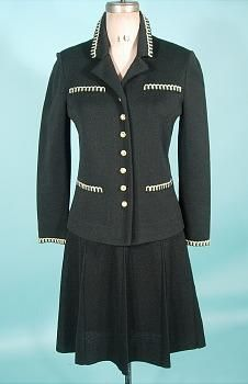"""1970's """"Chanel"""" Suit or """"St. John"""" Suit of Black Knit with Gold Braid Trim"""
