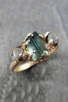 7+Non-Traditional+Engagement+Ring+Stones+That+Are+Trending+Big+Time+via+@PureWow raw diamonds blue green