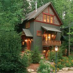 green siding red trim Beautiful cabin, via this slideshow for inspiring small homes and great tips and ideas for living small. Cabin Exterior Colors, Cottage Exterior, House Paint Exterior, Exterior Paint Colors, Cabin Paint Colors, Exterior Siding, Lake Cabins, Cabins And Cottages, Cabin Homes