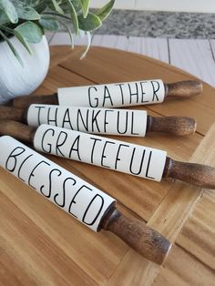 These mini rolling pins are the perfect addition to your decor. They are perfect for tiered trays! Each are stained in a dark walnut and then hand painted white. High quality permanent vinyl is used for the phases. The Mini Rolling Pins are 7 inches. Barn Wood Crafts, Wood Burning Crafts, Felt Christmas Decorations, Christmas Crafts, Farmhouse Rolling Pins, Diy Arts And Crafts, Diy Crafts, Cricut Craft Room, Dark Walnut