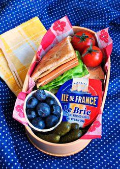 Vegetarian mini french picnic lunch - vegetarian ham  turkey sammie, mini brie, blueberries  pickles