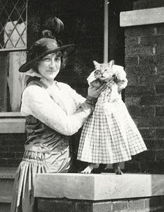 "You always have to have the ""cat in the dress"" shot. early 1900s"