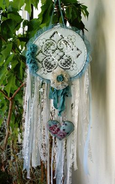 Boho Dreamcatcher, Bohemian Dream Catcher, Boho Mobile, Shabby Chic Weddind Decor, Shabby Chic Dreamcatcher, Lace Dreamcatcher, Boho Wedding   This gorgeous dreamcatcher is made of a metallic hoop which has been covered with pale blue satin ribbon. At the center of the hoop, there is a stunning vintage doily in a very light blue. Its a very old doily which must be stitched with Hollie point stitch; a very old embroidery technique . A wonderful vintage machine lace in cyan blue trim all…