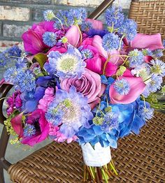 Whimsical Bouquet - The wiry stems of ageratum and pincushion flowers that rise above the roses, calla lilies, and hydrangeas in this pastel purple and blue bouquet add a touch of whimsy. Rich in both color and texture, this bouquet is perfect for pairing with a simple satin or sheath dress.