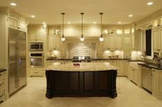 Love the huge island in the middle of this kitchen.