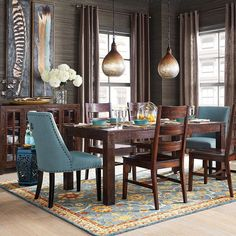 Our versatile Parsons Dining Collection mixes well with traditional or modern pieces, like our Corinne Linen Cornflower Dining Chairs, for example. We think that's why this style has remained popular for so long! #pier1 #diningroomdecor