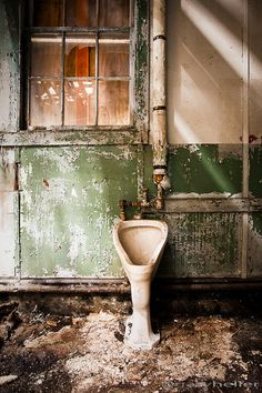 old urinal or toilet in an abandoned building