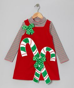 This sweet little set is what every girl dreams of, and then some. The playful candy cane appliqués on the comfy corduroy jumper set the stage for a great day, while the cozy top brings the whole special ensemble together. Size note: Infant sizes include bodysuit in place of top.
