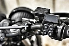 """1988 Honda NX650 sporting Land Rover headlights, cellphone-programmable electronics, a Reinschüssel--giant fuel tank--and even a power jack, so Tobi's friends """"can charge their iPhones to keep up with their Pinterest bulls--t."""""""