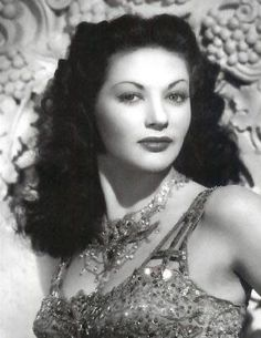 Yvonne De Carlo (also played on the Munsters TV show) like Lucille Ball was a gorgeous fashion model before becoming famous as a comedienne.