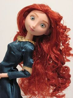 Merida doll from the Disney Store (I personally prefer this version to the Mattel version). Love the expression and the hair!!!