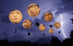 """Lightning strikes the Alpine mountains over Garmisch-Partenkirchen as balloons, made by the """"ONE"""" campaigning organisation, depicting leaders of the G7 countries are inflated in Garmisch-Partenkirchen June 7, 2015. Leaders are (L-R) German Chancellor Angela Merkel, U.S. President Barack Obama, French President Francoise Hollande, Japanese Prime Minister Shinzo Abe, British Prime Minister David Cameron, Italian Prime Minister Matteo..."""