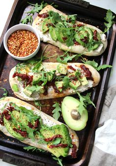 A new take on traditional avocado toast - theseVegan Cream Cheese Avocado Flatbreads are layered with cream cheese, sun-dried tomatoes, avocado slices and arugula.