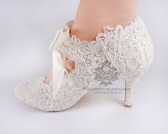 Beautiful lace shoes with feminine ribbons and pearls.