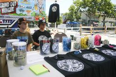 Dylan Morrish and Caleb Luther helping out at the Grind Out Hunger merch table during the Los Altos Stride and Ride Festival