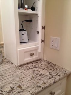 hidden home for electric razor charge station, with outlet inside cabinet
